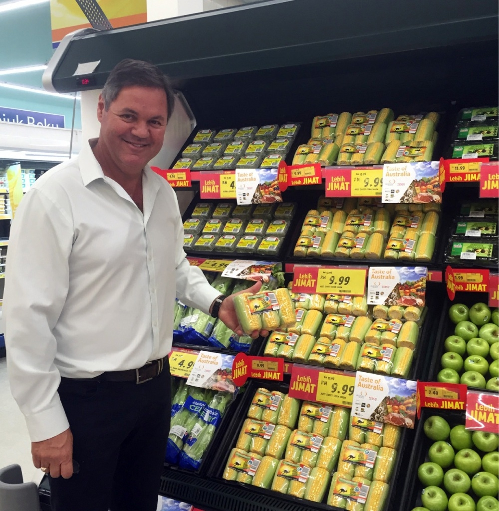 Jim Trandos with WA sweet corn in a Tesco Malaysia store.