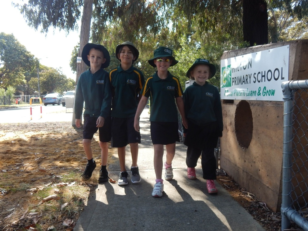 Hilton Primary School Year 2 students Robert Wood, Dean Tidswell, Destiney Madden and Hope Addison were among more than 150 students walking to school.