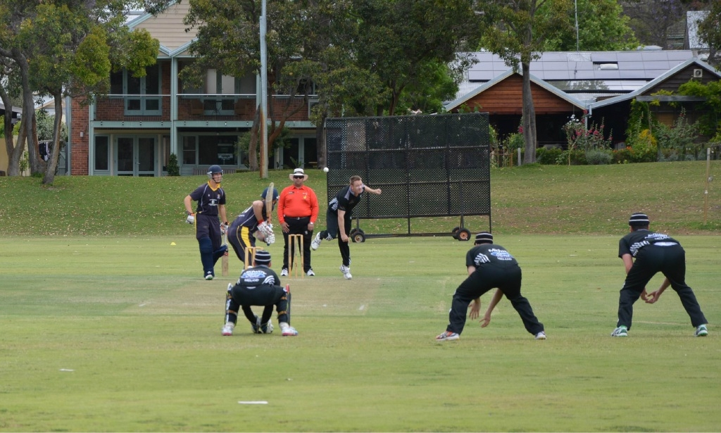 Tim Armstrong bowls to a Claremont-Nedlands batsman.