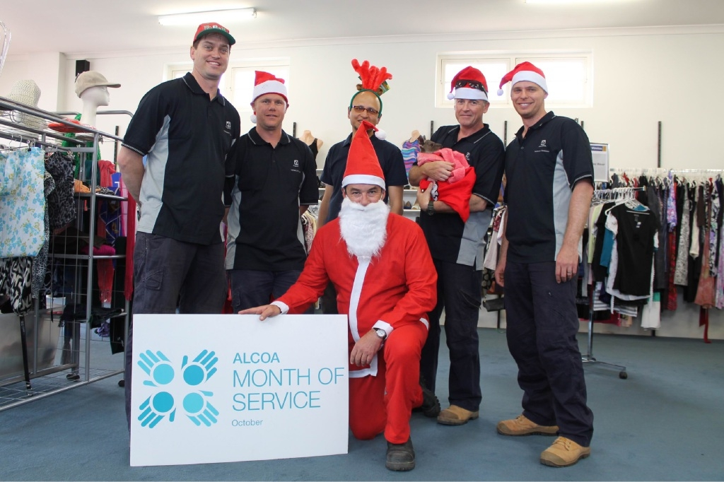 Pinjarra Alcoa Refinery employees and Joey the kangaroo get ready for Christmas at Vinnies Shop in Pinjarra.