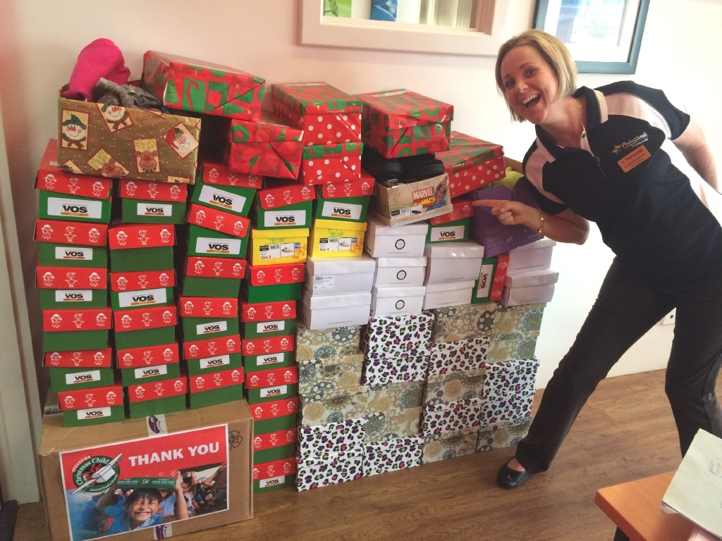 Jo Lockwood-Hall with some of the boxes filled with gifts for children overseas.
