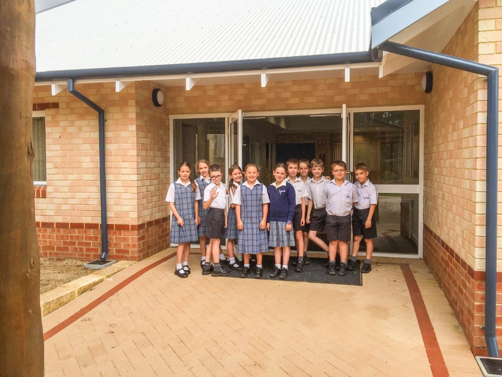 Students in front of the new teaching block.