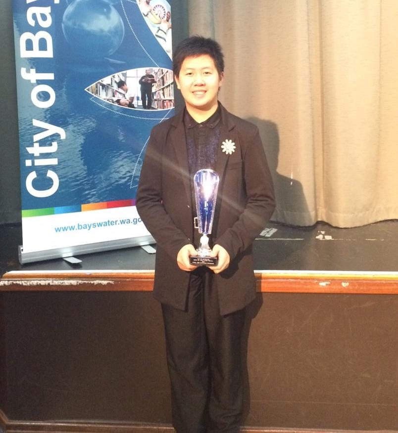 Pianist Shuan Hern and one of his two awards.