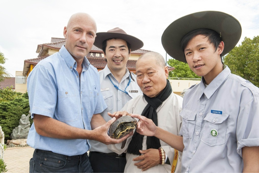 Glen Coupar, Minh Le, Venerable Thich Phuoc Nhon and Tuan Huang with the captured red-eared slider turtle, which is an invasaive pest.