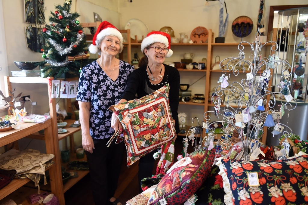 Sheila Tuddenham and Gayle Bukey showing some of the things you can buy at the Murray Arts and Crafts Society's Christmas fair. Picture: Jon Hewson        www.communitypix.com.au d445932