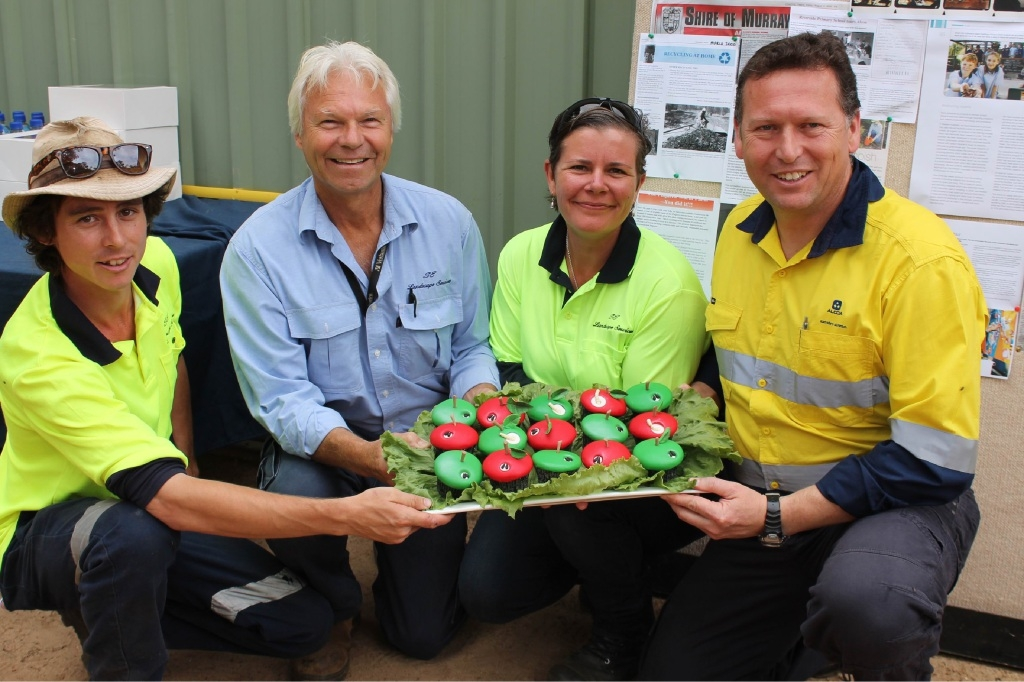 Visitors Cam Turner and Donald Sutherland, site manager Kelly Roberts and Pinjarra Refinery manager Simon Pascoe at the worm farm.