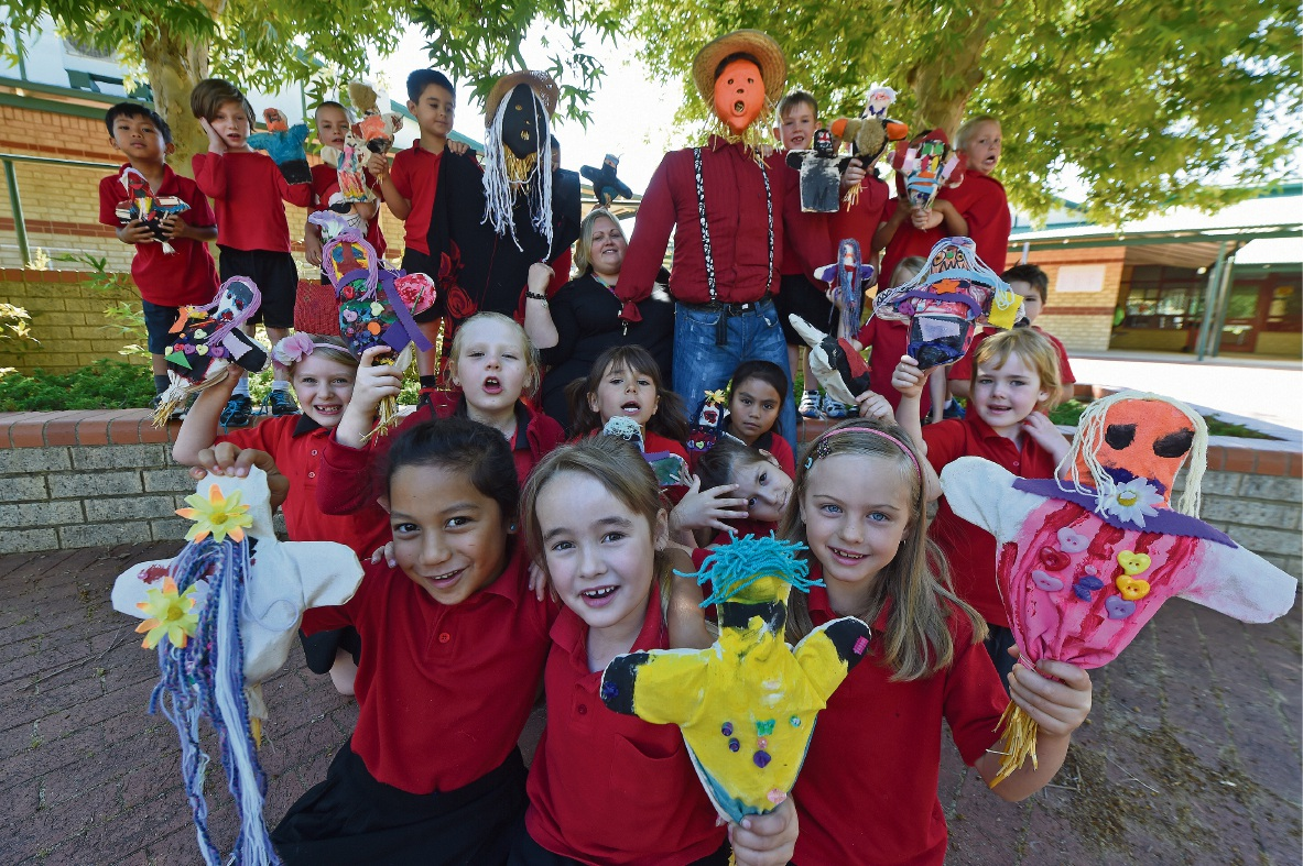 Leda Primary School students with their scarecrow creations for the festival.