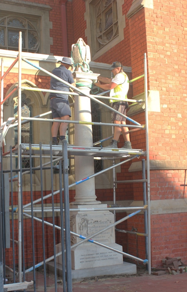 Perth Monumental Works stonemasons Martin Clifford and Leon Robotham remove the 123-year-old monument.