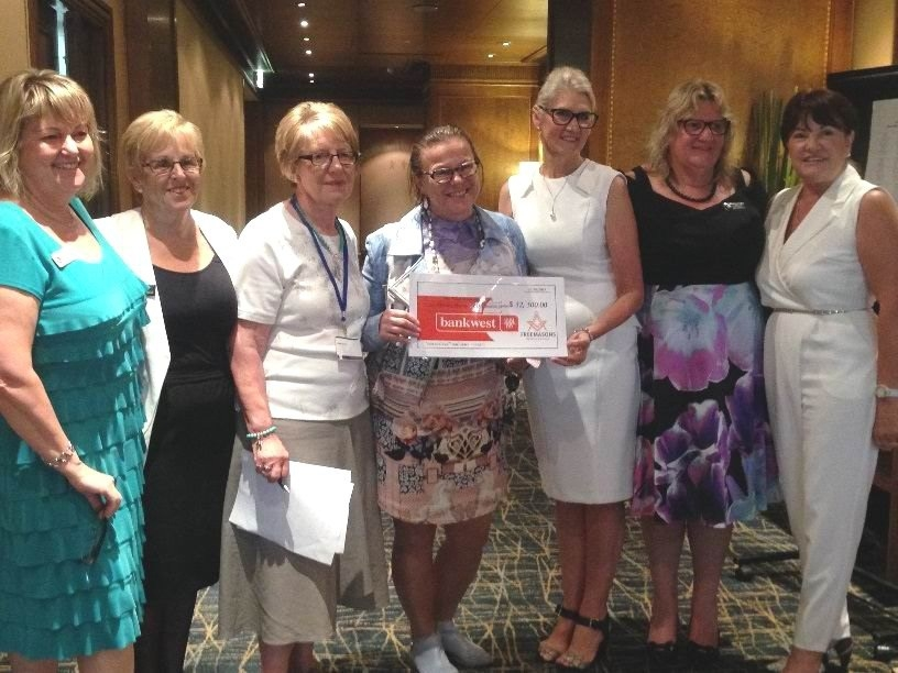Professor Fiona Wood receives the cheque from |Freemasons WA Ladies Group members Shelley Stokes, Kay Paddick, Lynn Nichols, Beth Jancec, Jenni McDowall and Jenny Breeden.