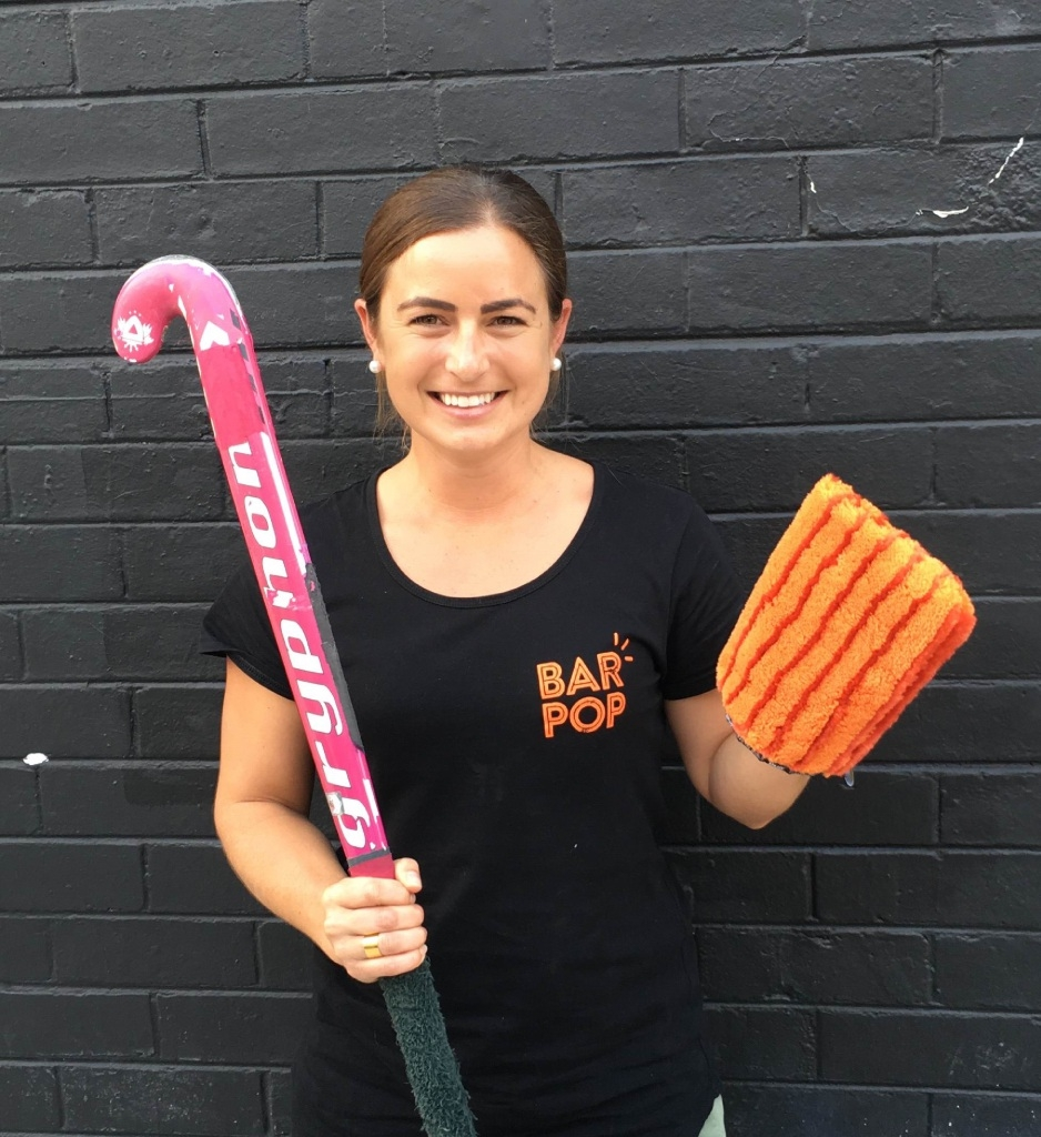 Ex-Hockeyroo player Jade Taylor swaps a hockey stick for a cleaning glove.