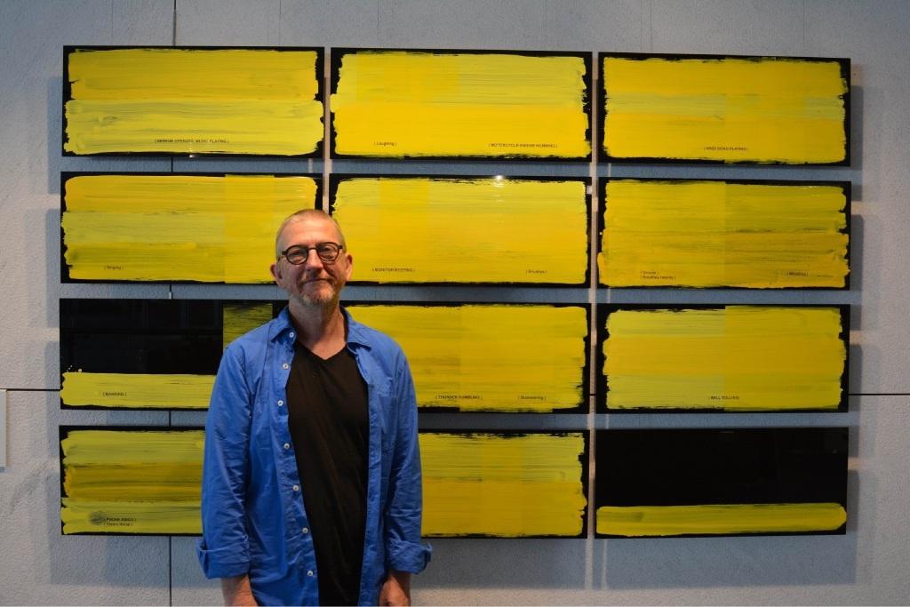 Artist Jurek Wybraniec and his winning piece Yellow (panels 1 to 12).