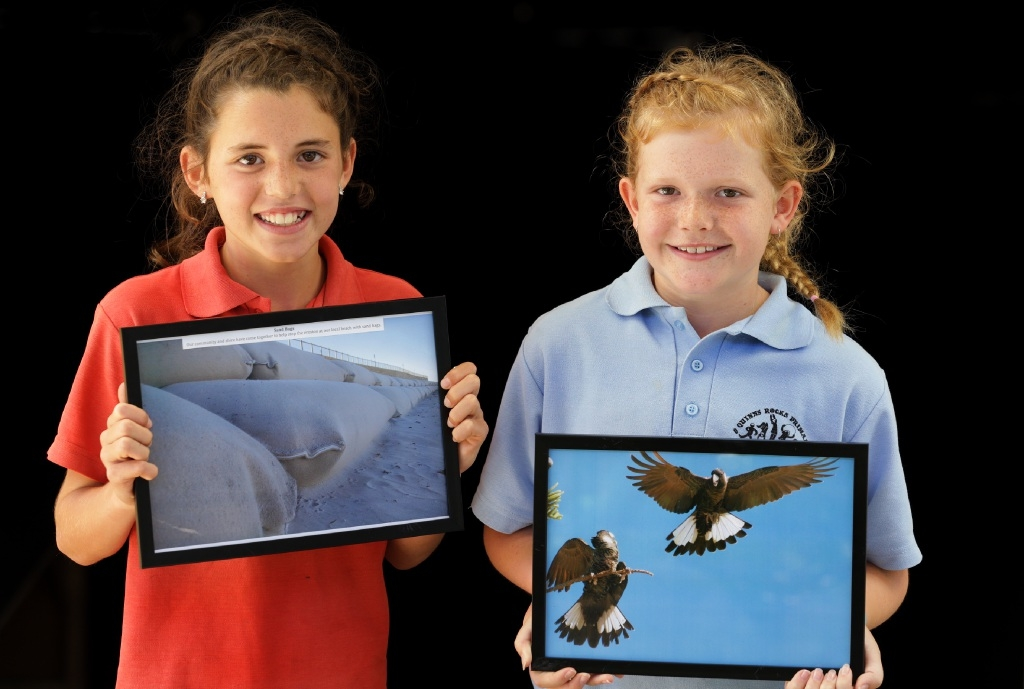 Year 4 students Mia Robis and Kiana White with their award winning photographs.        Picture: Martin Kennealey        d445961