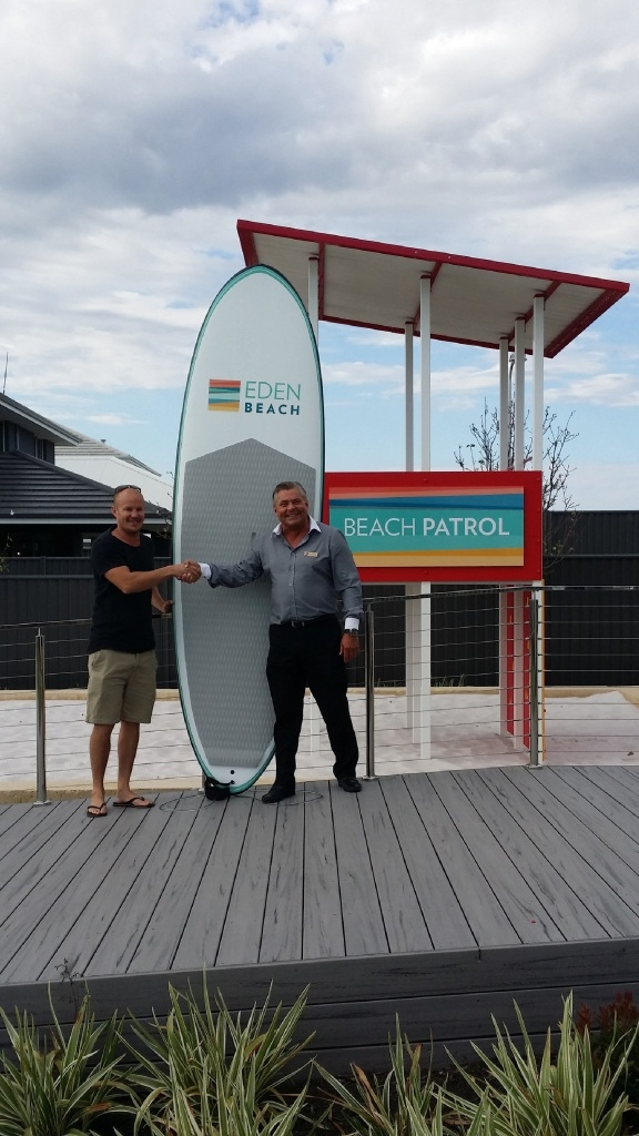 Paddleboard winner Toby Lindsay and Eden Beach estate manager Heinz Pfenninger.