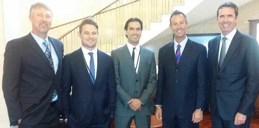 Marc Crisp (second left) and Ray Bartholomew (centre), joined Falcons coach Bill Monaghan, president Brett Raponi and MLC Peter Collier at Parliament House to celebrate their contribution to the club.
