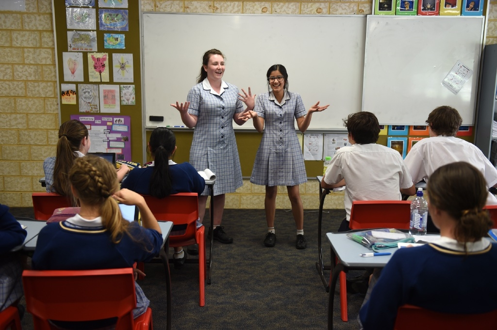 Lauren Ritchie and Deepali Rajawat practise their speeches in front of their classmates. Picture: Jon Hewson        www.communitypix.com.au   d445498