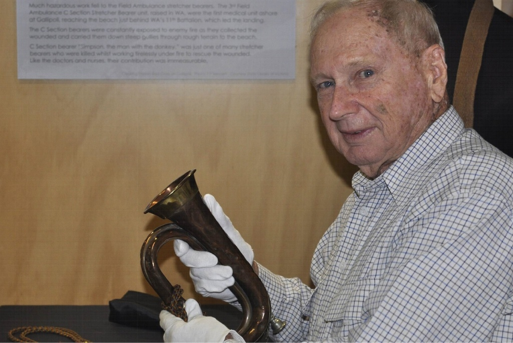 George Roscoe holds the treasured family memento in his hands for the first time since it was donated to the WA Museum.