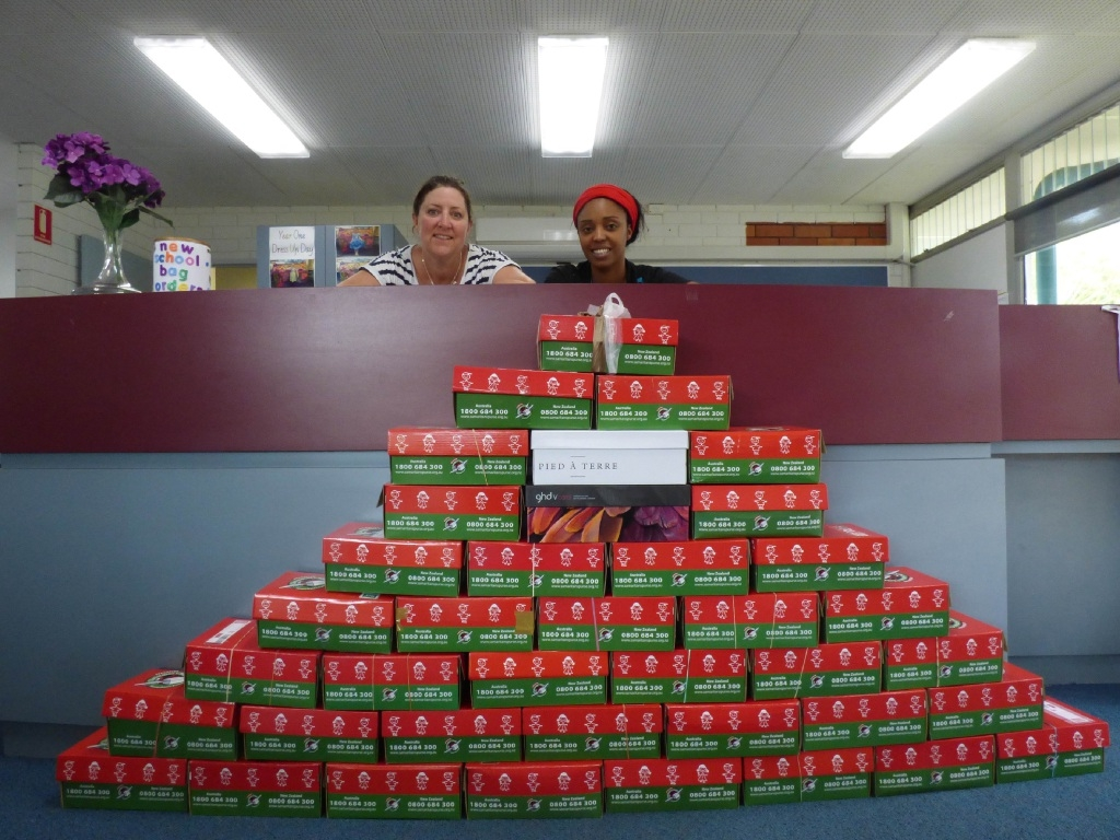 Parent Tarryn Lee and chaplain Jade Crompton with boxes filled for Operation Christmas Child at Padbury Primary School.