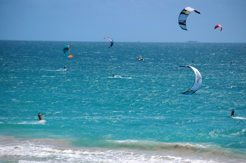 Kitesurfers competing in the Redkite Charity Downwinder, which supports children and young people living with cancer.