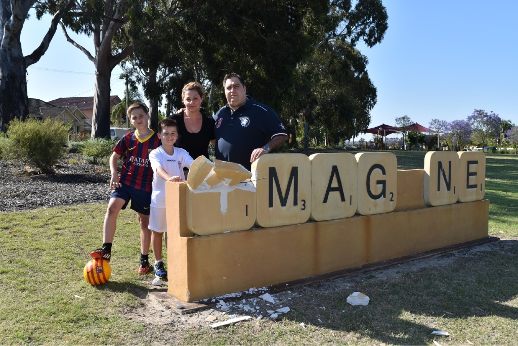 Gianluca, Massimo, Deborah and Angelo Paiano with the damaged Ellesmere Park sculpture.       Picture: Caitlin Tiller