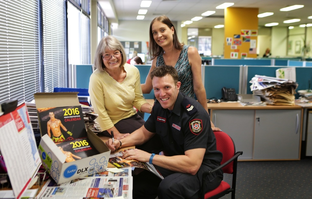 Firefighter Bryn Nightingale with Judy Shelton and Suzanne Bevan at the Weekender's office. Picture: Martin Kennealey  d445674