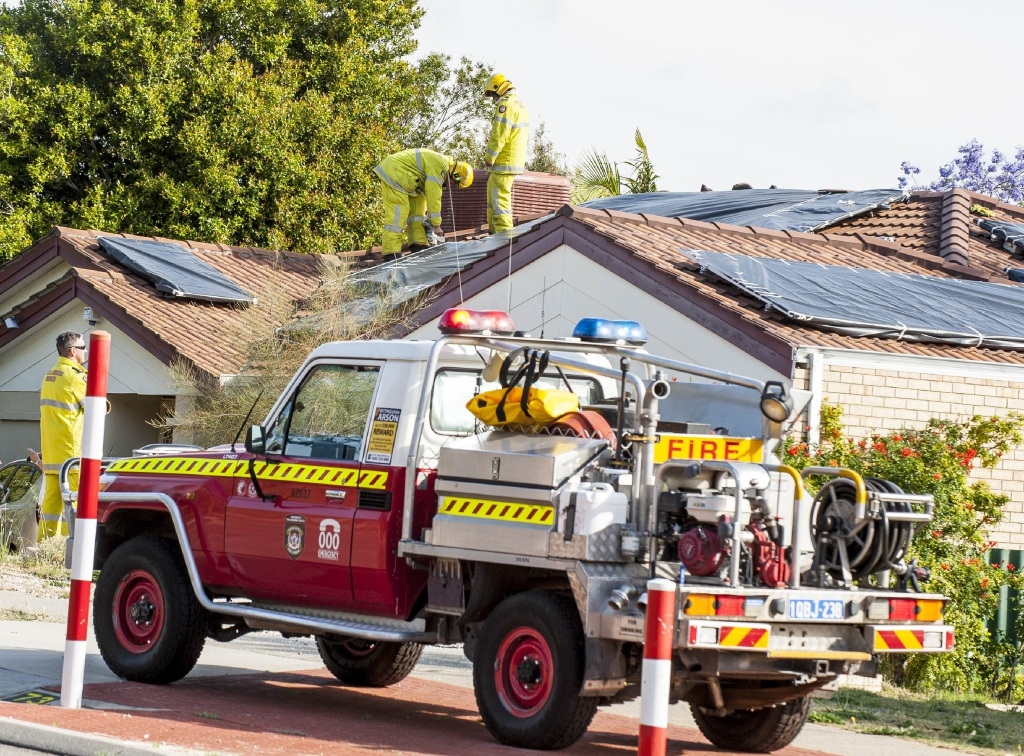 Fire crews covered the solar panels.Picture: Josh Tucker