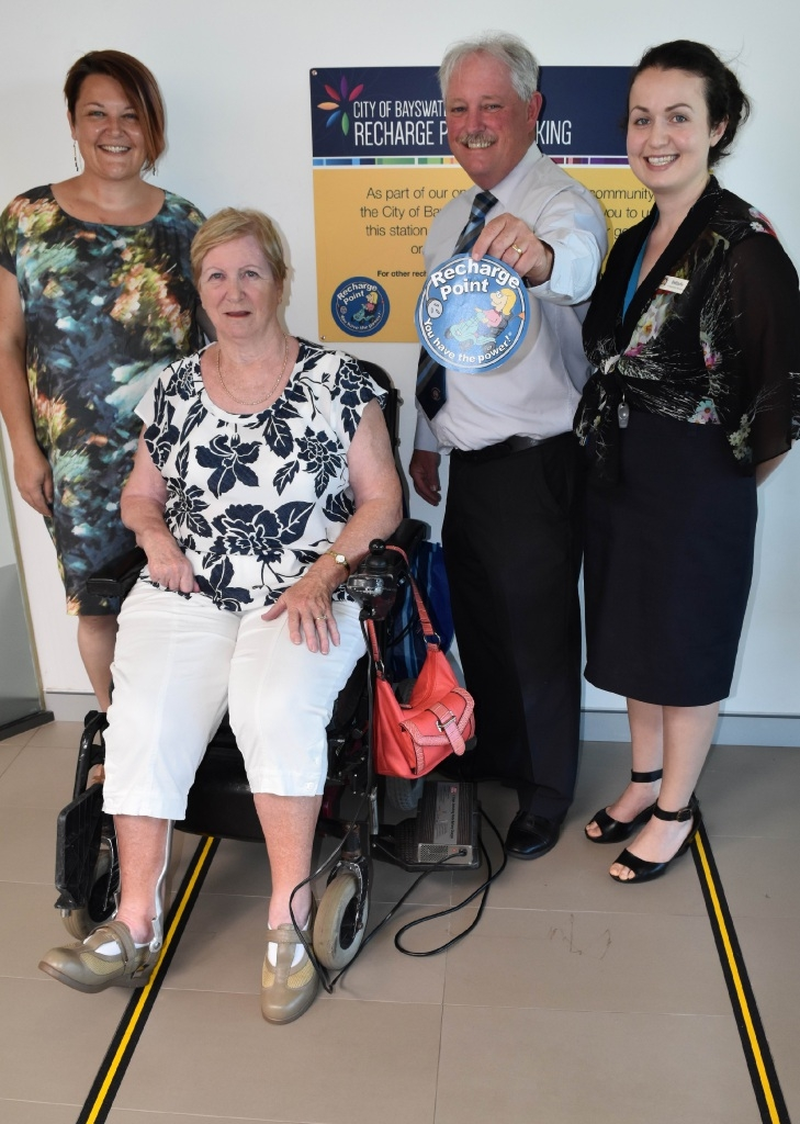 Councillor Catherine Ehrhardt, Irene Hollister, Mayor Barry McKenna and Belinda Grandoni at the charging station. Picture: Lauren Pilat