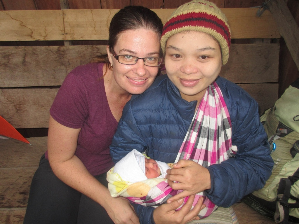 Midwife Monica Parker with Gul Weh and her new baby.