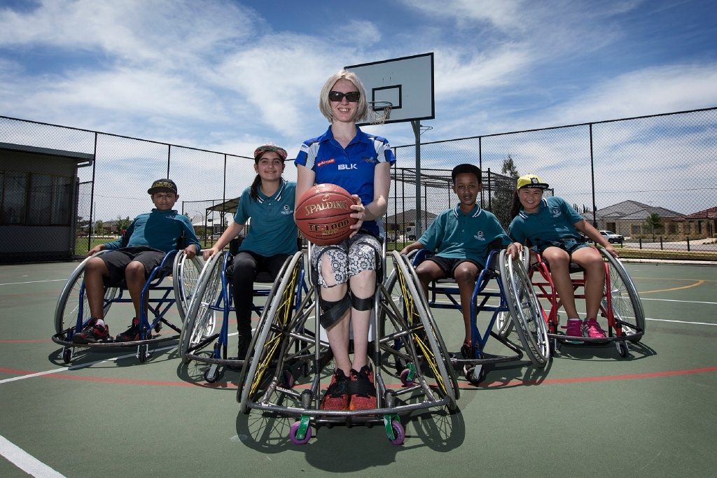Aaron John, Zainab Walizada, Amber Merritt, Meareg Abraha, and Chelsea Chan get a feel of what's it like to play sport while sitting in a wheelchair.  Picture: Will Russell        d445971