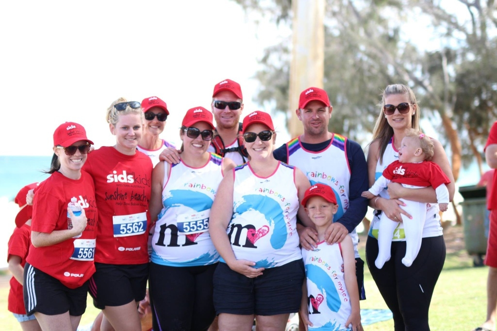 Stephanie O'Lone, Rebecca Farrell, Daneka Carnegie, Courtney Howarth, Macey Howarth, Melanie Manning (pregnant with Eden), Sean Manning, Chase Manning, Rachel Fraser and Paisley Manning at the 2015 Sunshine Beach Run earlier this year.