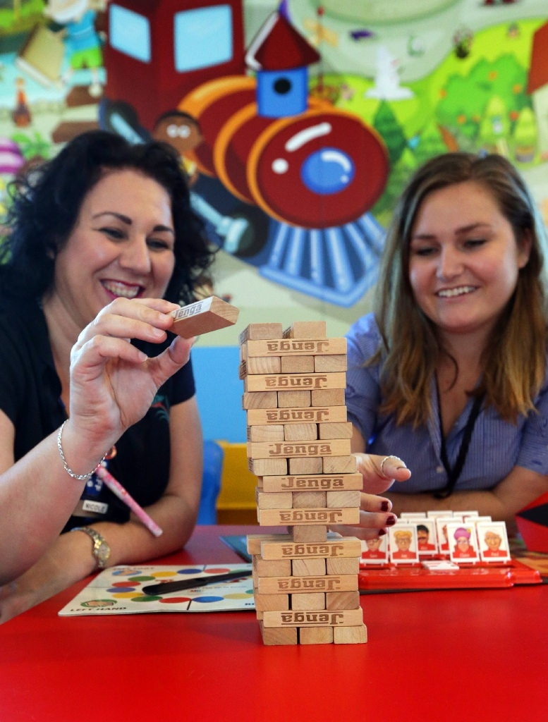 Branch librarian Nicole Thompson and library services officer Jess Parsons try Jenga at Clarkson Library. Picture: Martin Kennealey d446092