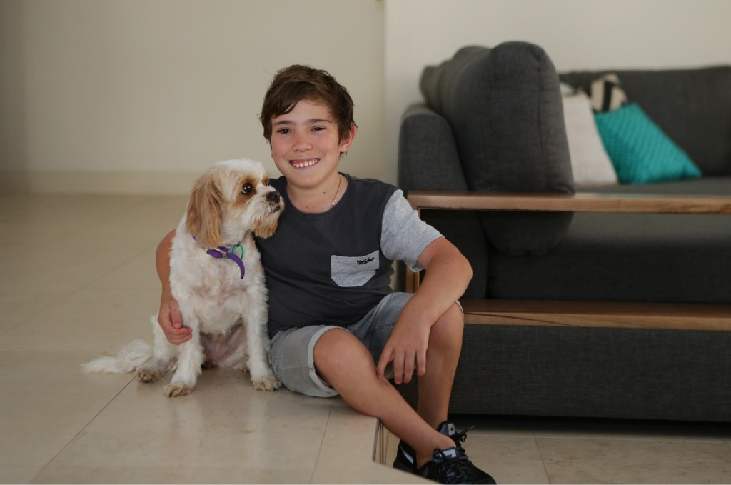 Coby Antonio now has the strength to take family dog Tisha for a walk. Picture: Martin Kennealey                          d446237