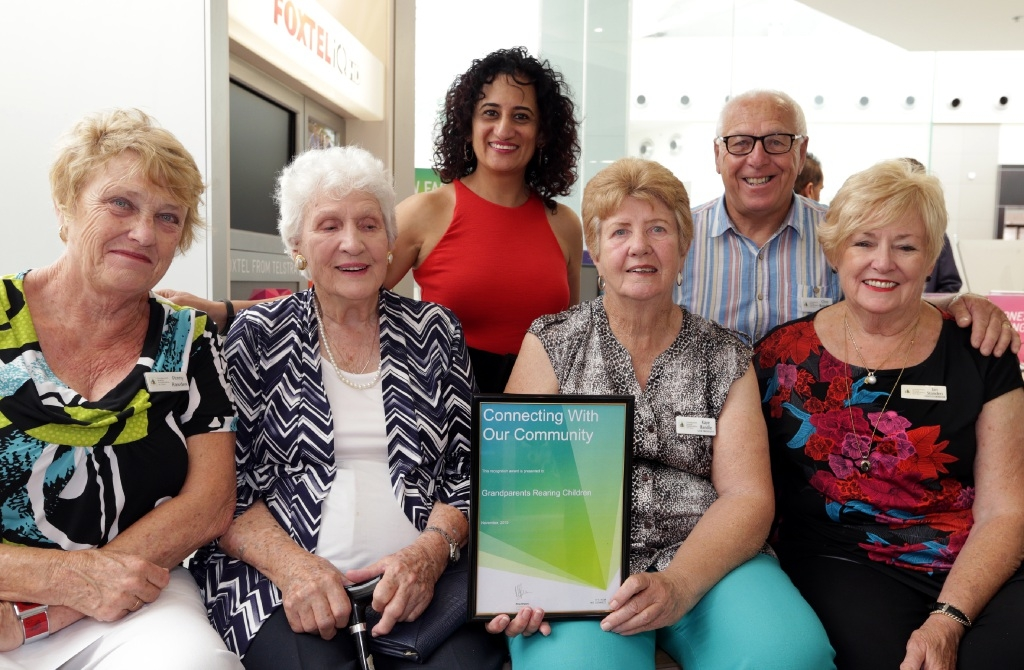 Members of Grandparents Rearing Grandchildren WA with Telstra store owner Rina Bhabra..  Picture: Martin Kennealey         d446376