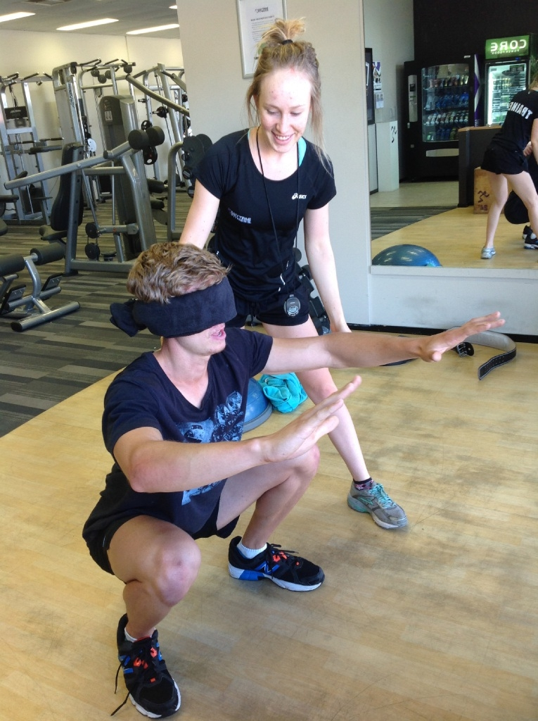 Amy Breur with an Anytime Fitness Beldon client.