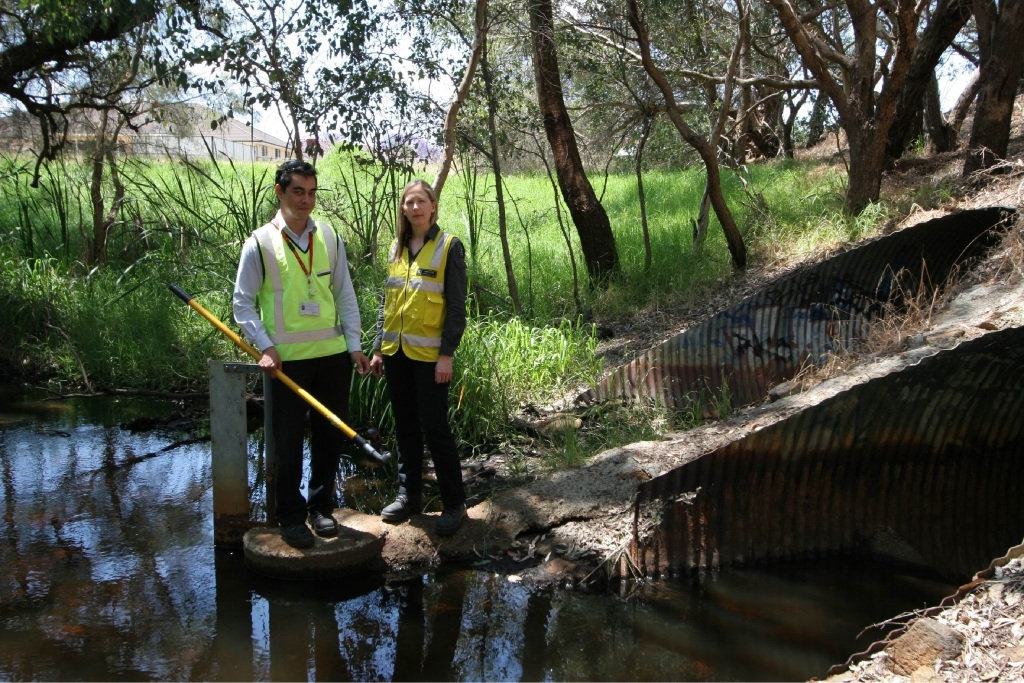 City of Swan environmental health officer Scott Favacho and Department of Environmental Regulation light industry program officer Lara Saunder conducting a water quality test at Bennett Brook.