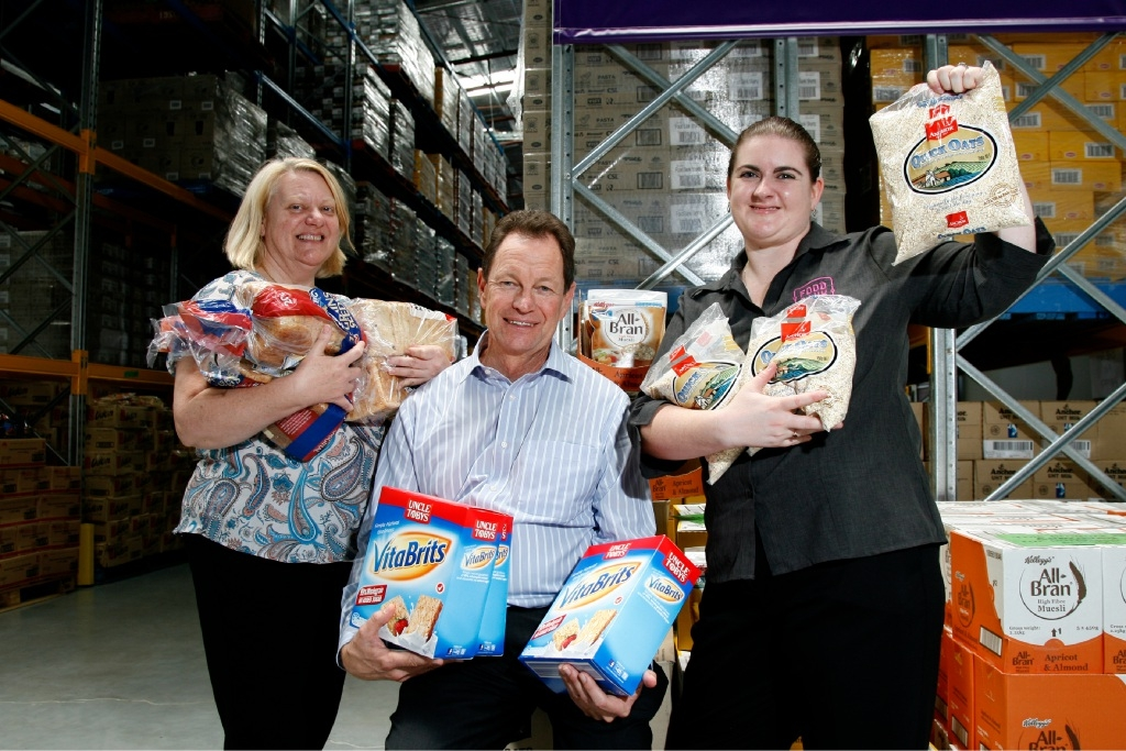 Margaret Marriott,  of Warnbro Community High School, Rex Milligan, of Healthy Food For All, and Foodbank school breakfast program co-ordinator Miranda Chester with healthy breakfast ingredients. Picture: Marie Nirme        www.communitypix.com.au   d446279