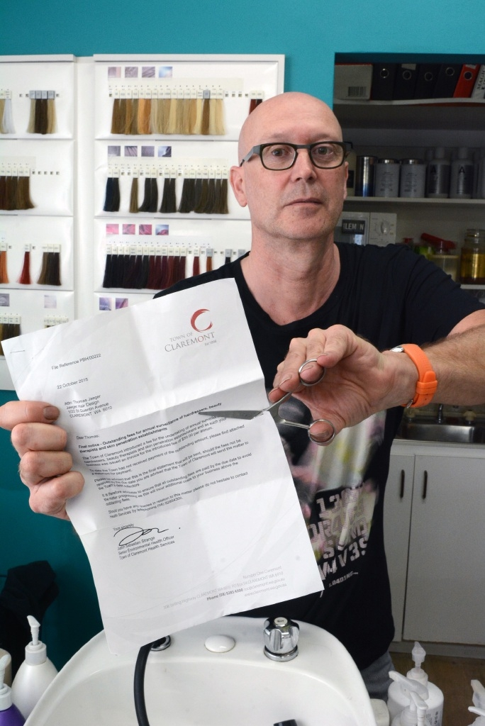 Thomas Jaeger, who has operated Jaeger Hair Design for 28 years, is outraged that the council wants to charge hairdressers and barbers a $50 inspection fee.        Picture: Jon Bassett