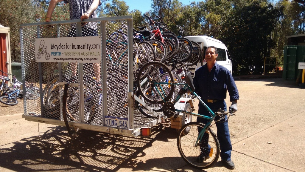 A Shire of Kalamunda staff member loads the bikes onto a Bicycles for Humanity truck.