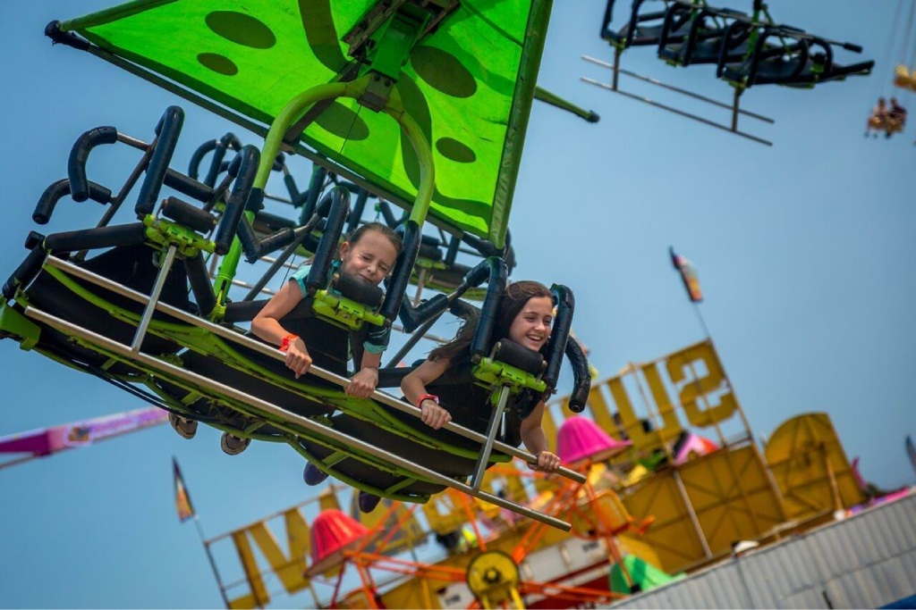 Sierra Prestianni (11), of Brigadoon, and Jessie Counsel (11), of Wanneroo, ride The Cliff Hanger at the Royal Show.