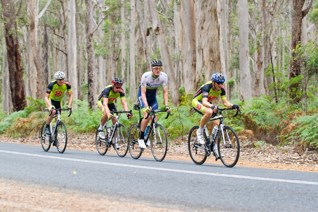 Northern Beaches Cycling Club rider, Tim James, leads out from Orica GreenEdge Champion Luke Durbridge, Duncan Rogers and John Hanson. Picture: Gordon Haywood