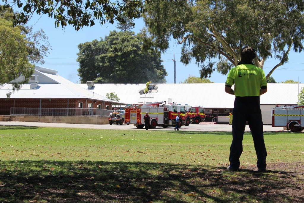 Firefighters on the roof of Osborne Park Primary School. Picture: Julian Wright.