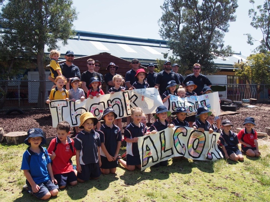 Pre-primary students at Secret Harbour Primary School say thank you to Alcoa Kwinana |Refinery employees for building a new playground.