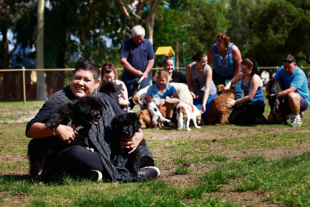Melissa Mitchell (front) with two of her dogs, Yoghurt and Charlie, with other local dog owners enjoying a day out at Tom Wright Park's dog exercise area. Picture: Marie Nirme