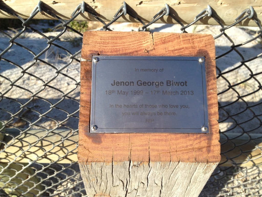 The memorial plaque of Jenon George Biwot.
