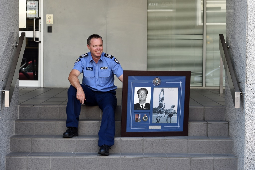Acting Senior Sergeant Nathan Trenberth with a commemoration to former East Fremantle player and police officer Con Regan. Picture: Jon Hewson        www.communitypix.com.au   d446603
