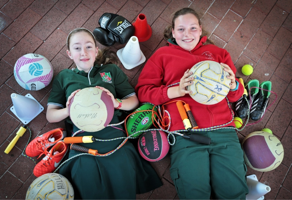 Sasha Saunderson (12) and Indiana Shailes (11) with some of the items collected. Picture: David Baylis        www.communitypix.com.au   d444006