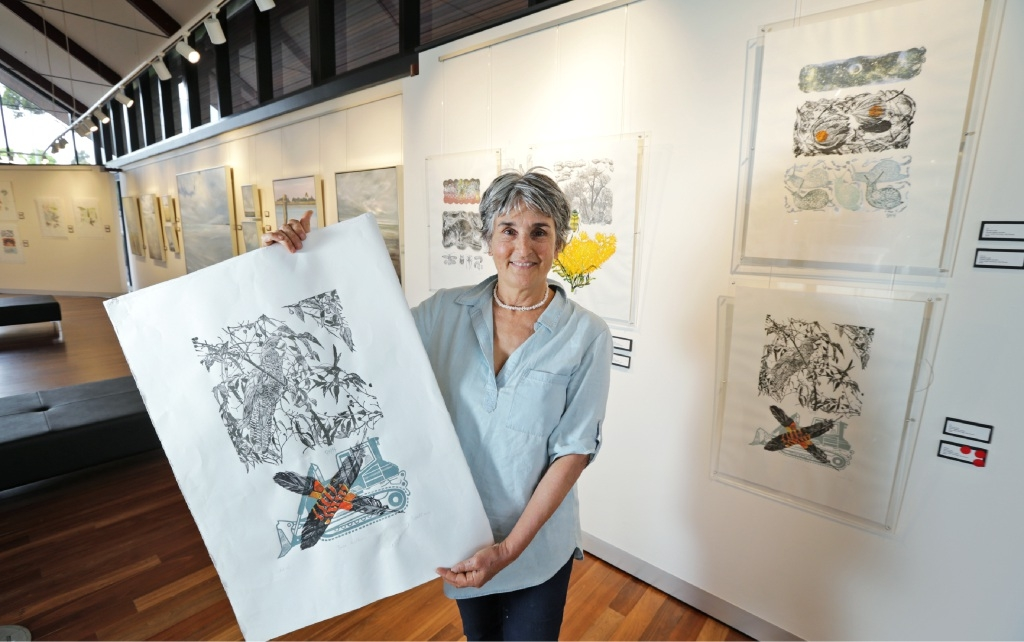Kalamunda artist Sandra Hall with some of her multi-block lino prints. She is holding a piece called Save Wilkins Road. Picture: David Baylis        www.communitypix.com.au   d446742