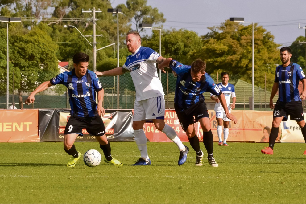 Bayswater City's Gustavo Giron Marulanda and Paul McCarthy tackling a Floreat player last week. Picture: Sabata Creatives