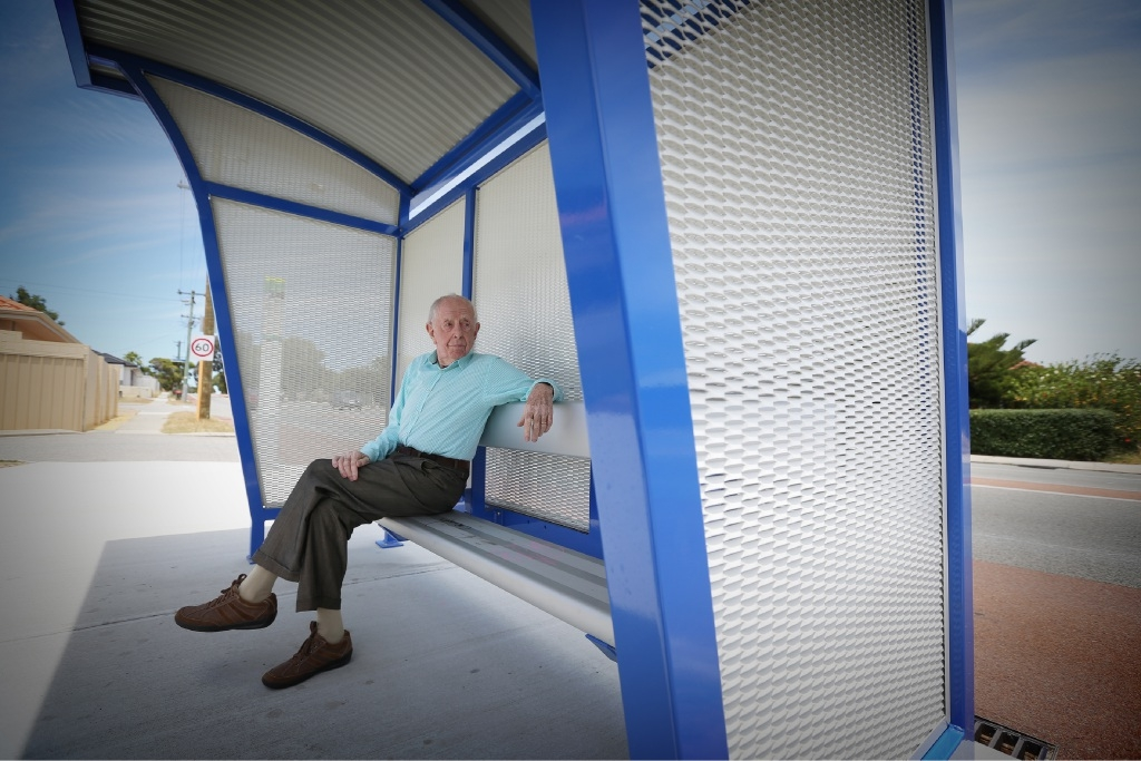 Ben Maguire enjoys the new bus shelter on Karrabil Way.Picture: Andrew Ritchie www.communitypix.com.au d446736
