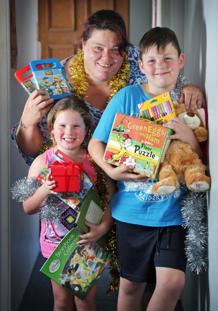 Xmas joy in toys, books. The Smith Family Christmas Appeal