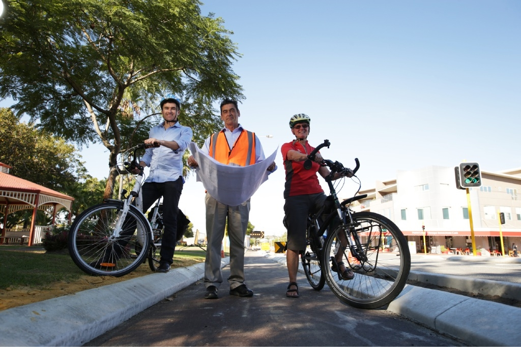 Vincent Mayor John Carey and engineering operations manager Con Economo with cyclist Geraldine Box.   Picture: Andrew Ritchie